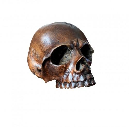 A walnut memento mori skull.Italy 17th century
