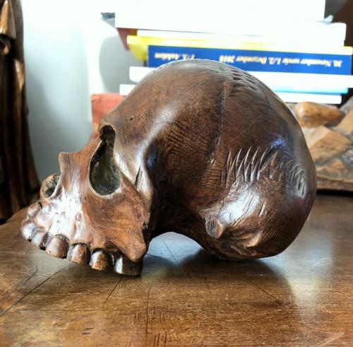Curiosities  - A walnut memento mori skull.Italy 17th century