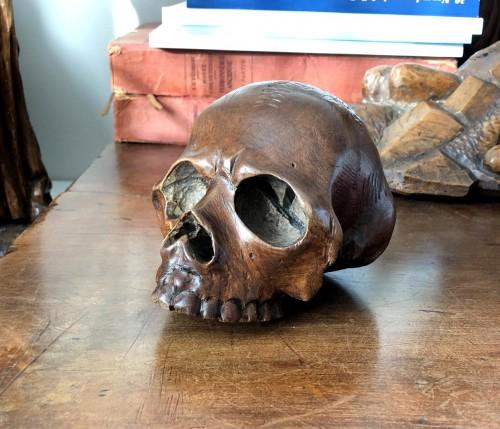 A walnut memento mori skull.Italy 17th century -