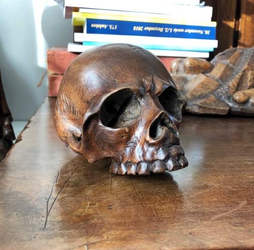 - A walnut memento mori skull.Italy 17th century