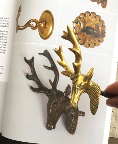 Curiosities  - A gilt bronze stag head hook.Nuremberg.Early 17th century.