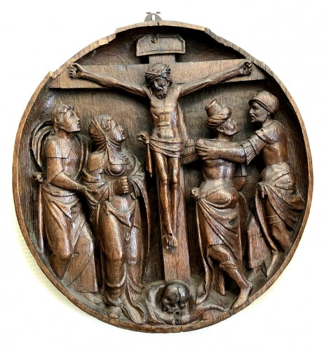 An oak Tondo of the crucifixion.Flemish 16th century