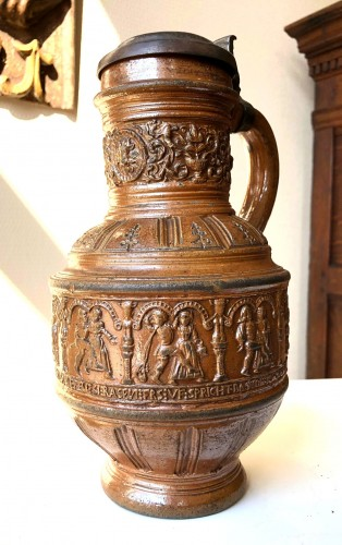 Religious Antiques  - A pewter mounted stoneware jug.Raeren.Dated 1597