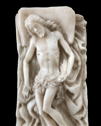 An alabaster carving of the entombed Christ.Circa 1600 - Religious Antiques Style