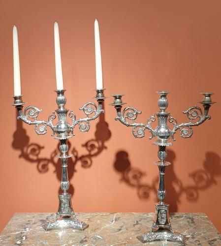 - Pair of silver candelabra