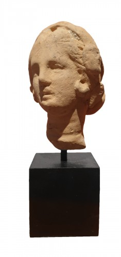 Hellenistic terra-cotta head of a woman