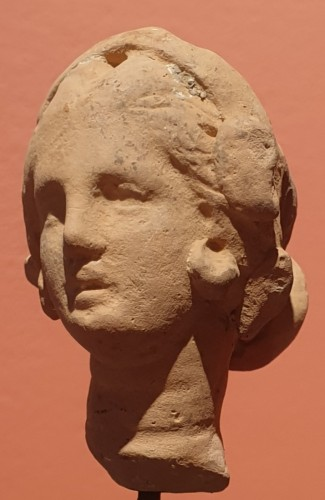Hellenistic terra-cotta head of a woman  - Ancient Art Style
