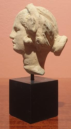 Hellenistic terra-cotta head of a woman  -