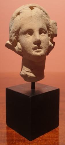 - Hellenistic terra-cotta head of a woman