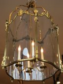 An important four ligth lantern in Louis XV style