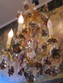 A chandelier with fruits and bunch of grapes