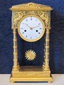 A 1st Empire period (1804 - 1815) portico clock
