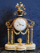 A Louis XVI period (1774 - 1793) portico clock