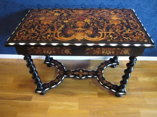 A late XIXth century marquetry table in Louis XIV style