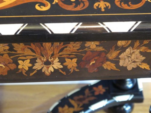 A late XIXth century marquetry table in Louis XIV style -