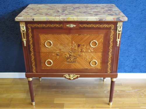 A Napoleon III period (1848 - 1870) commode in Louis XVI style.
