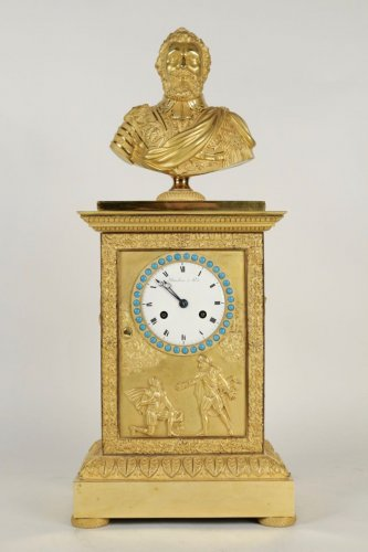 A Restauration period (1815 - 1830) clock with a bust of the king Henri IV