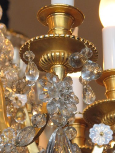 19th century - A Louis XVI style nine-light chandelier.