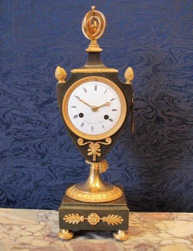 A 1st Empire period clock in escutcheon shapes