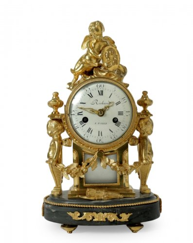 A Louis XVI period small clock