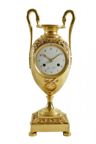 A 1st Empire clock in the shape of a vase