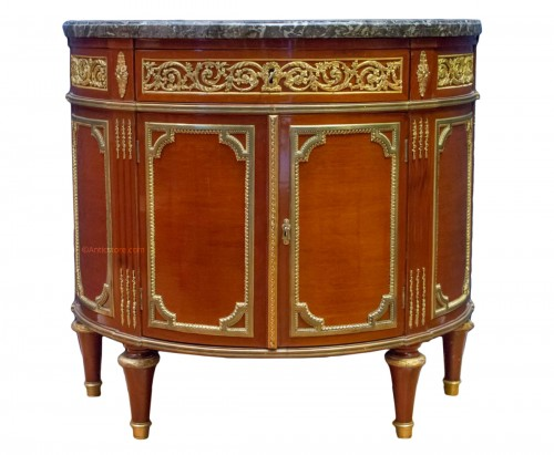 A Louis XVI style mahagony demi-lune commode
