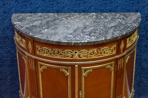 19th century - A Louis XVI style mahagony demi-lune commode