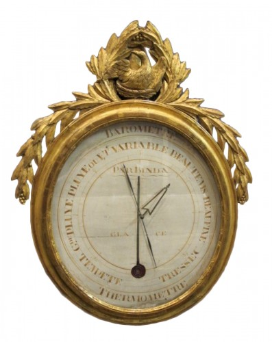 A Louis XVI giltwood  barometer - thermometer