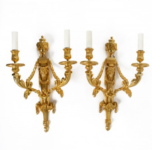A Louis XVI style pair of wall lights