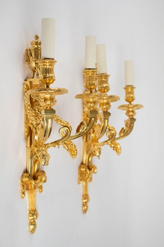 A Louis XVI style pair of wall lights -