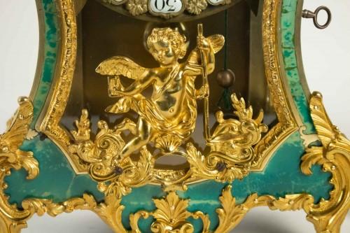 A Louis XV green horn bracket clock -