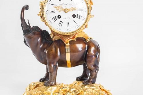 """A gilt bronze clock """"à l'éléphant"""". -"""