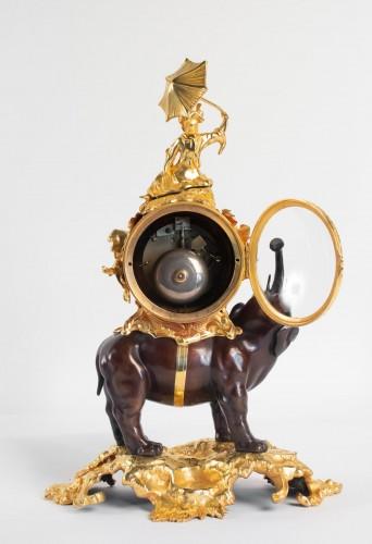 """- A gilt bronze clock """"à l'éléphant""""."""