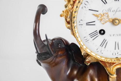 """Antiquités - A gilt bronze clock """"à l'éléphant""""."""
