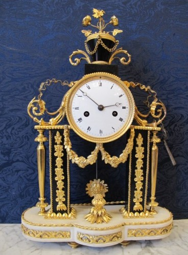 A Louis XVI portico clock