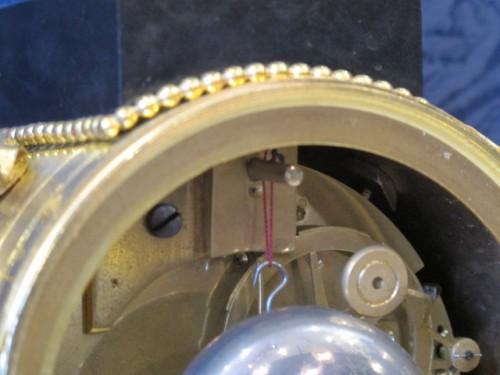 A Louis XVI portico clock -