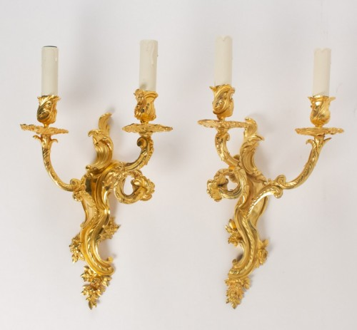 - A Pair of Louis XV style wall lights.