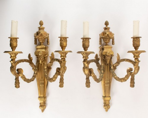 A Pair of Louis XVI style wall lights -