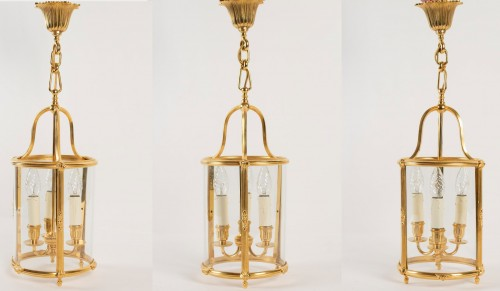 Three Louis XVI style lanterns.