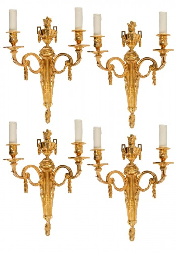 Four Louis XVI style wall-lights .
