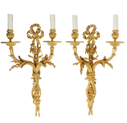 Pair of gilt bronze two-lights scones, late 19th century
