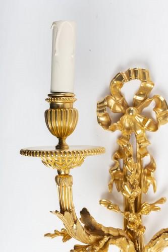 Lighting  - Pair of gilt bronze two-lights scones, late 19th century