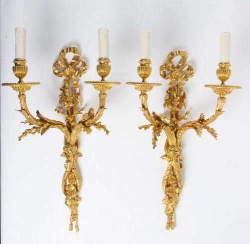 19th century - Pair of gilt bronze two-lights scones, late 19th century