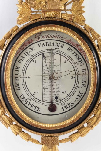 A Louis XVI period (1774 - 1793) barometer - thermometer. -