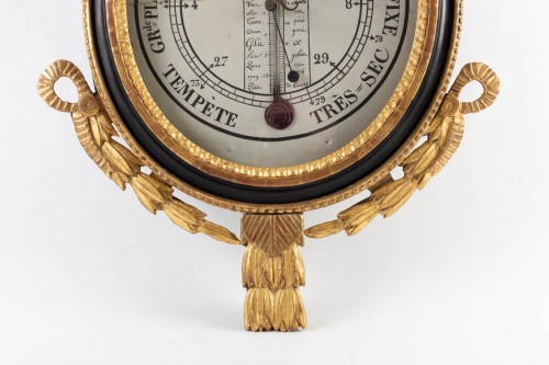 18th century - A Louis XVI period (1774 - 1793) barometer - thermometer.