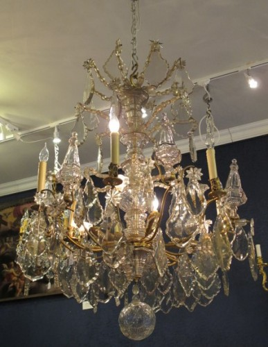 An important cut crystal and gilt bronze chandelier