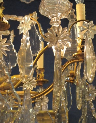 An important cut crystal and gilt bronze chandelier -
