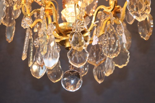 A Louis XV style chandelier. - Lighting Style