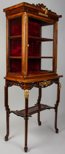 A Vitrine-cabinet-on-stand attributed to Gabriel Viardot -
