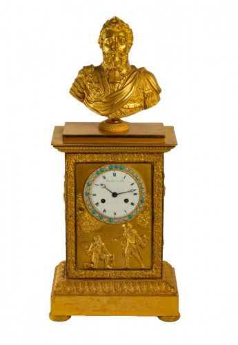 A Restauration period clock with a bust of the king Henri IV